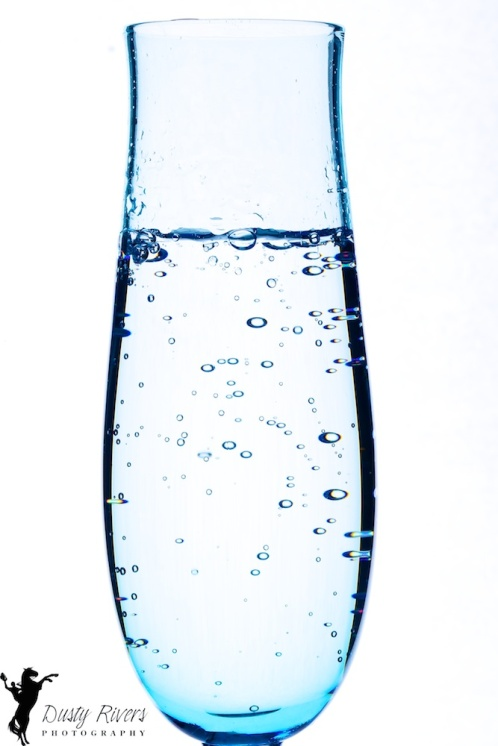 A toast to Friday, bubbles in a blue glass, Dusty Rivrs Photography, dustyriversphotography.com