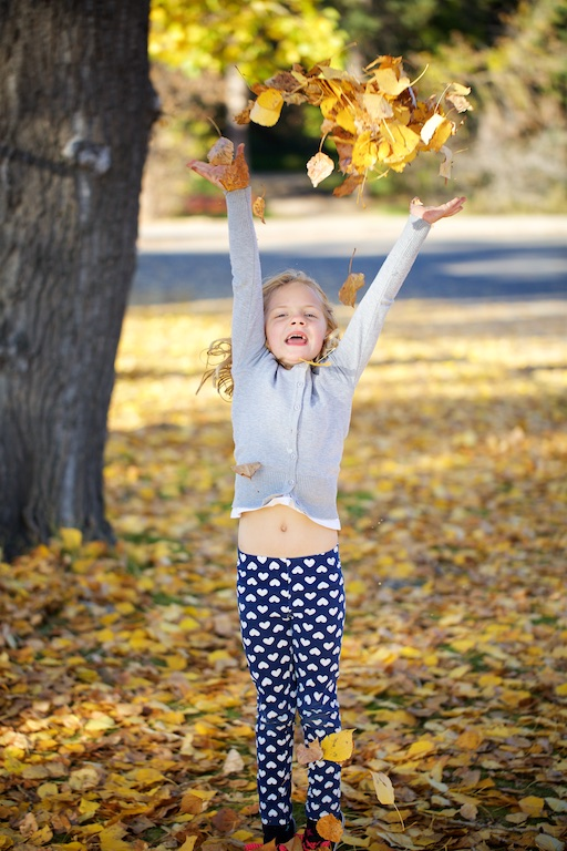 Fish Creek Park, family photos, little girl, throwing leaves, Calgary, YYC, Dusty Rivers Photography, dustyriversphotography.com