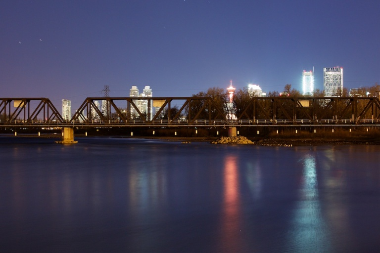 Calgary Skyline, Bow River, railroad bridge, nighttime, zoom, YYC, Dusty Rivers Photography, dustyriversphotography.com